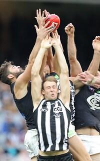 Levi Casboult plucks a mark over Ben Reid and a huge pack in Carlton's impressive win