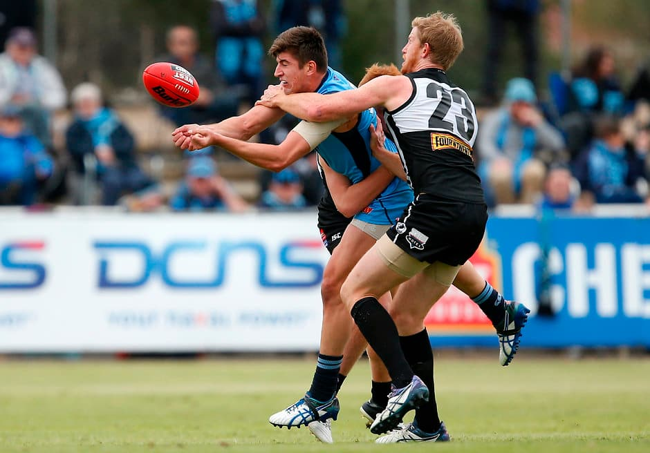 ADELAIDE, AUSTRALIA - MAY 07: Patrick Wilson of the Blues is tackled by Matthew Lobbe of the Magpies during the 2017 SANFL round 05 match between the Port Adelaide Magpies and Sturt at Alberton Oval on May 07, 2017 in Adelaide, Australia. (Photo by James Elsby/AFL Media)