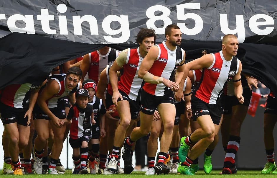 MELBOURNE, AUSTRALIA - MAY 13:  Jarryn Geary of the Saints leads his team through the banner during the round eight AFL match between the St Kilda Saints and the Carlton Blues at Etihad Stadium on May 13, 2017 in Melbourne, Australia.  (Photo by Quinn Rooney/Getty Images/AFL Media)
