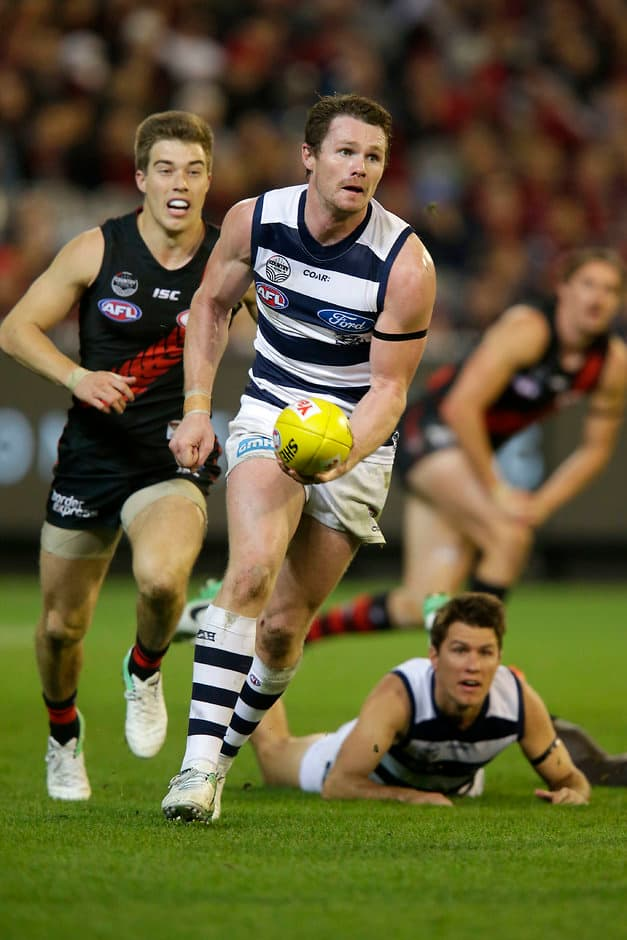 MELBOURNE, AUSTRALIA - MAY 13: Patrick Dangerfield of the Cats handballs during the 2017 AFL round 08 match between the Essendon Bombers and the Geelong Cats at the Melbourne Cricket Ground on May 13, 2017 in Melbourne, Australia. (Photo by Darrian Traynor/AFL Media)