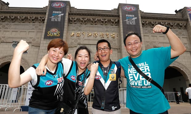 SHANGHAI, CHINA - MAY 14: Power fans pose for a photograph during the 2017 AFL round 08 match between the Gold Coast Suns and Port Adelaide Power at Jiangwan Sports Stadium on May 14, 2017 in Shanghai, China. (Photo by Michael Willson/AFL Media)