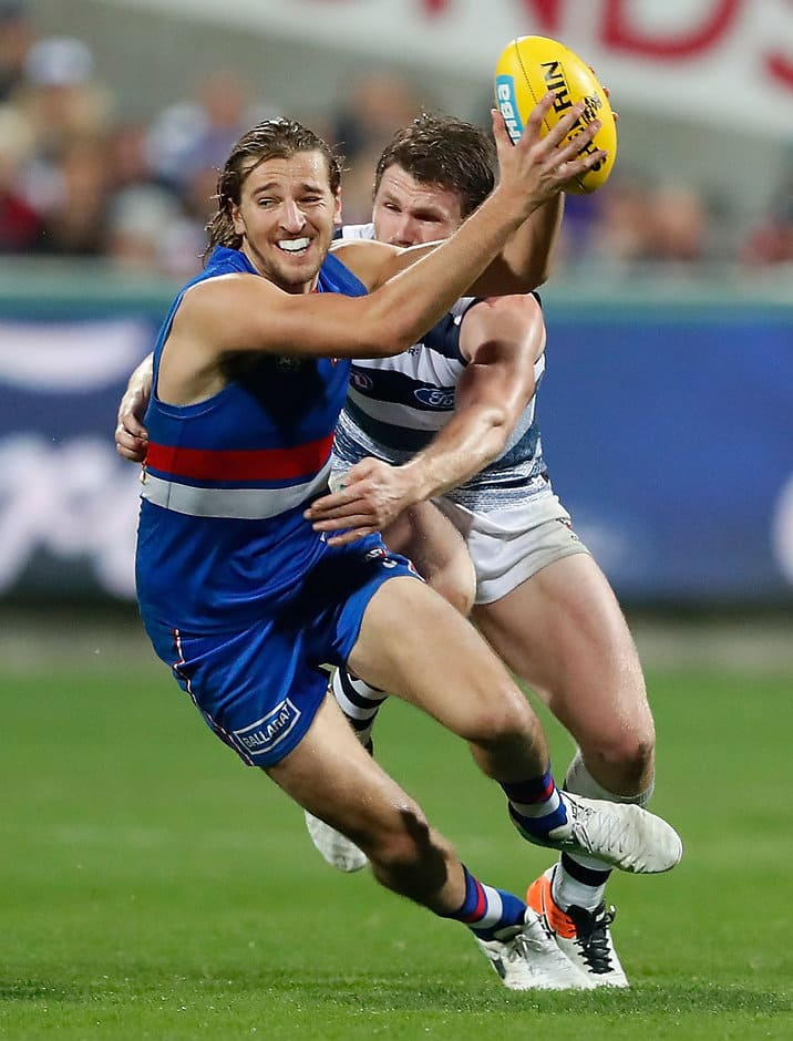 GEELONG, AUSTRALIA - MAY 19: Marcus Bontempelli of the Bulldogs is tackled by Patrick Dangerfield of the Cats during the 2017 AFL round 09 match between the Geelong Cats and the Western Bulldogs at Simonds Stadium on May 19, 2017 in Melbourne, Australia. (Photo by Adam Trafford/AFL Media)