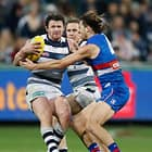 GEELONG, AUSTRALIA - MAY 19: Patrick Dangerfield of the Cats is tackled by Marcus Bontempelli of the Bulldogs during the 2017 AFL round 09 match between the Geelong Cats and the Western Bulldogs at Simonds Stadium on May 19, 2017 in Melbourne, Australia. (Photo by Adam Trafford/AFL Media)