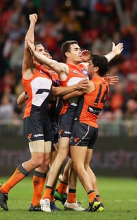 The Giants get around match-winner Jeremy Cameron (centre)
