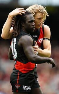 Anthony McDonald-Tipungwuti and Dyson Heppell celebrate a Bombers goal