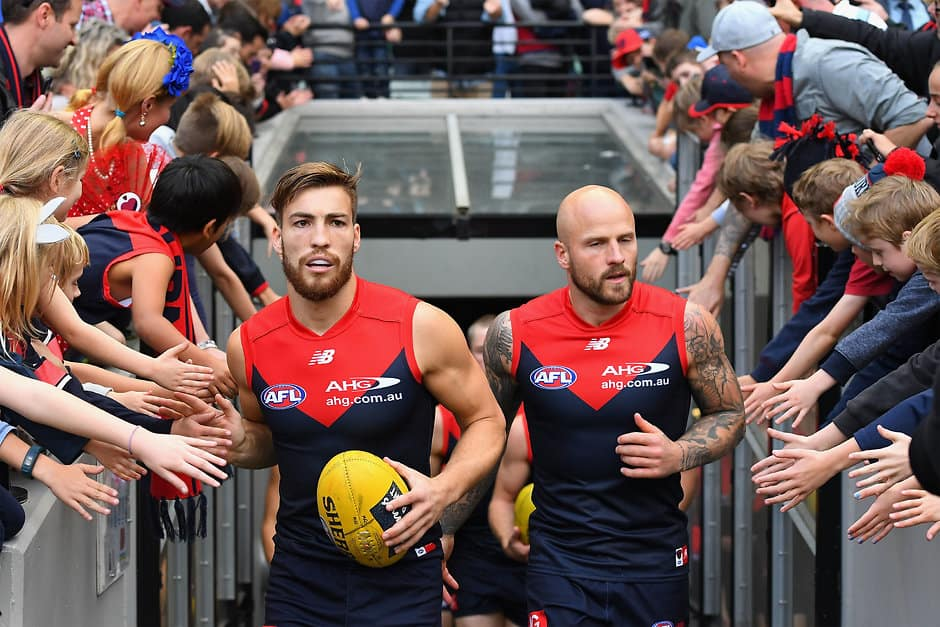 MELBOURNE, AUSTRALIA - MAY 21:  Jack Viney and Nathan Jones of the Demons  lead their team out for warm up during the round nine AFL match between the Melbourne Demons and the North Melbourne Kangaroos at Melbourne Cricket Ground on May 21, 2017 in Melbourne, Australia.  (Photo by Quinn Rooney/Getty Images/AFL Media)