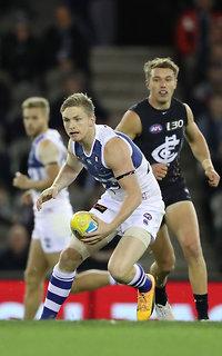 Jack Ziebell attempts to get a handball away under pressure