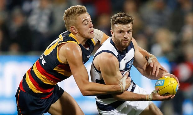 GEELONG, AUSTRALIA - JUNE 02: Jordan Murdoch of the Cats is tackled by Hugh Greenwood of the Crows during the 2017 AFL round 11 match between the Geelong Cats and the Adelaide Crows at Simonds Stadium on June 02, 2017 in Geelong, Australia. (Photo by Michael Willson/AFL Media)