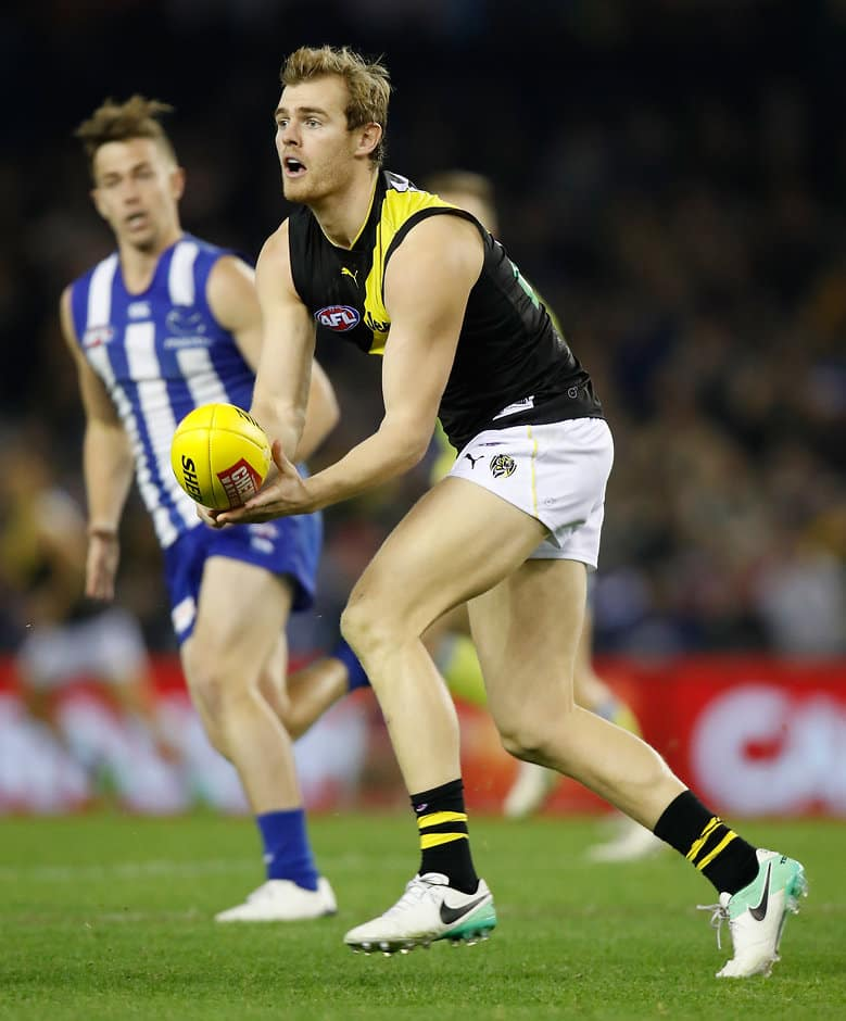 MELBOURNE, AUSTRALIA - JUNE 03: David Astbury of the Tigers in action during the 2017 AFL round 11 match between the North Melbourne Kangaroos and the Richmond Tigers at Etihad Stadium on June 03, 2017 in Melbourne, Australia. (Photo by Michael Willson/AFL Media)