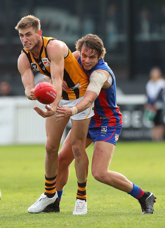 MELBOURNE, AUSTRALIA - JUNE 03:  Ryan Schoenmakers of Box Hill (L) handballs during the round seven VFL match between Port Melbourne and Box Hill at North Port Oval on June 3, 2017 in Melbourne, Australia.  (Photo by Graham Denholm/AFL Media/Getty Images)