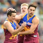 BRISBANE, AUSTRALIA - JUNE 10: Lewis Taylor of the Lions is congratulated by team mates during the 2017 AFL round 12 match between the Brisbane Lions and the Fremantle Dockers at the Gabba on June 10, 2017 in Brisbane, Australia. (Photo by Bradley Kanaris/AFL Media)