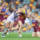 BRISBANE, AUSTRALIA - JUNE 10:  Dayne Zorko of the Lions runs the ball during the round 12 AFL match between the Brisbane Lions and the Fremantle Dockers at The Gabba on June 10, 2017 in Brisbane, Australia.  (Photo by Chris Hyde/Getty Images/AFL Media)