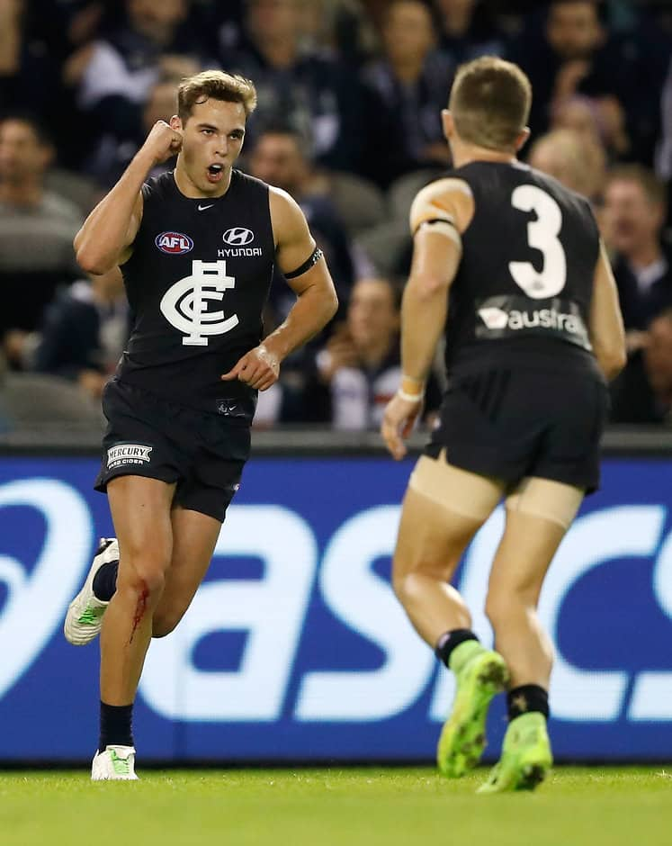 MELBOURNE, AUSTRALIA - JUNE 11: David Cuningham of the Blues celebrates a goal with teammates during the 2017 AFL round 12 match between the Carlton Blues and the GWS Giants at Etihad Stadium on June 11, 2017 in Melbourne, Australia. (Photo by Adam Trafford/AFL Media)