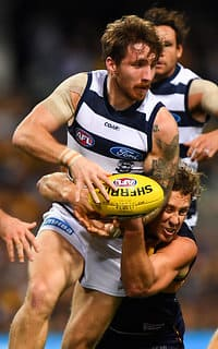 West Coast's Matt Priddis tackles Geelong's Zach Tuohy