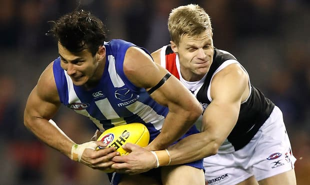 MELBOURNE, AUSTRALIA - JUNE 16: Robbie Tarrant of the Kangaroos is tackled by Nick Riewoldt of the Saints during the 2017 AFL round 13 match between the North Melbourne Kangaroos and the St Kilda Saints at Etihad Stadium on June 16, 2017 in Melbourne, Australia. (Photo by Michael Willson/AFL Media)