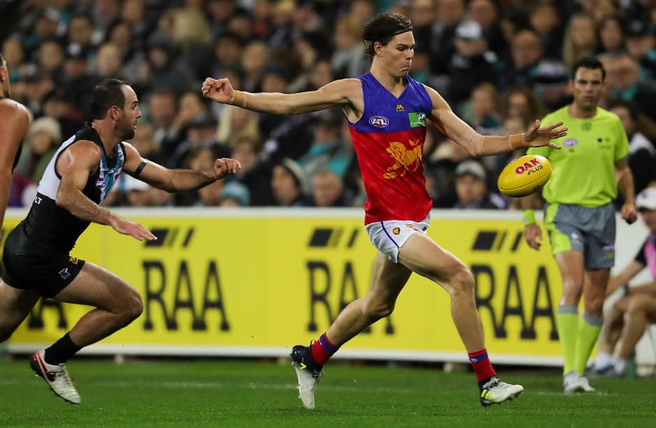 ADELAIDE, AUSTRALIA - JUNE 17: Eric Hipwood of the Lions chased by Matthew Broadbent of the Power during the 2017 AFL round 13 match between Port Adelaide Power and the Brisbane Lions at the Adelaide Oval on June 17, 2017 in Adelaide, Australia. (Photo by AFL Media)