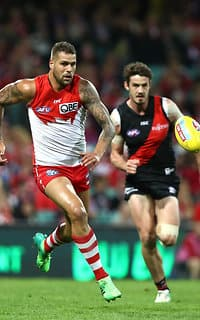 Lance Franklin competes with Michael Hartley for the ball