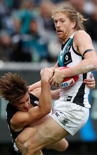 MELBOURNE, AUSTRALIA - JUNE 24: Aaron Young of the Power is tackled by Tom Phillips of the Magpies during the 2017 AFL round 14 match between the Collingwood Magpies and the Port Adelaide Power at the Melbourne Cricket Ground on June 24, 2017 in Melbourne, Australia. (Photo by Adam Trafford/AFL Media)