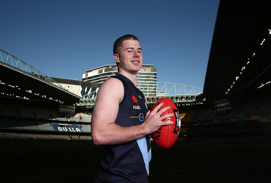 MELBOURNE, AUSTRALIA - JUNE 30: Jack Higgins of Vic Metro poses during the 2017 Under 18 Championships portrait session at Etihad Stadium on June 30, 2017 in Melbourne, Australia. (Photo by Scott Barbour/AFL Media)