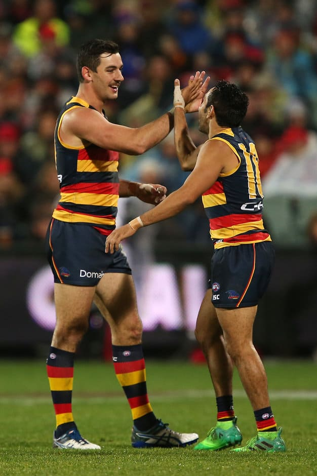 ADELAIDE, AUSTRALIA - JULY 07: Taylor Walker and Eddie Betts of the Crows celebrate a goal during the 2017 AFL round 16 match between the Adelaide Crows and the Western Bulldogs at the Adelaide Oval on July 07, 2017 in Adelaide, Australia. (Photo by James Elsby/AFL Media)
