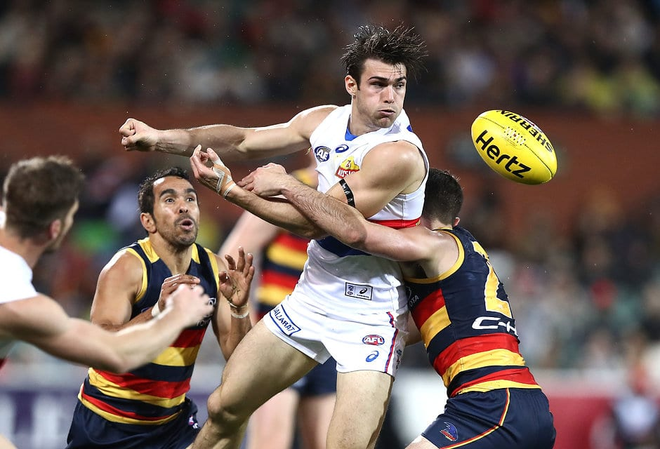 ADELAIDE, AUSTRALIA - JULY 07: Easton Wood of the Bulldogs handballs  during the round 16 AFL match between the Adelaide Crows and the Western Bulldogs at Adelaide Oval on July 7, 2017 in Adelaide, Australia.  (Photo by Ryan Pierse/Getty Images/AFL Media)
