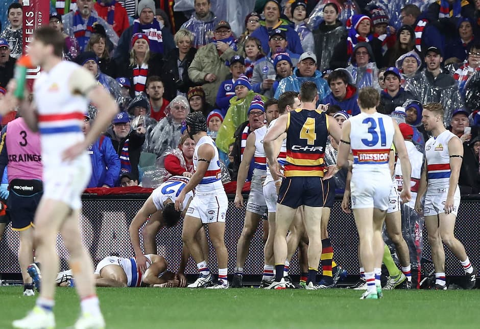 ADELAIDE, AUSTRALIA - JULY 07:  Jason Johannisen of the Bulldogs recovers after colliding with the goal post during the round 16 AFL match between the Adelaide Crows and the Western Bulldogs at Adelaide Oval on July 7, 2017 in Adelaide, Australia.  (Photo by Ryan Pierse/Getty Images/AFL Media)