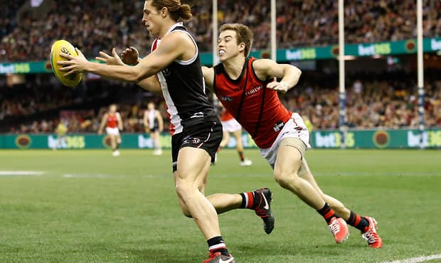 MELBOURNE, AUSTRALIA - JULY 14: Jack Steele of the Saints is tackled by Zach Merrett of the Bombers during the 2017 AFL round 17 match between the St Kilda Saints and the Essendon Bombers at Etihad Stadium on July 14, 2017 in Melbourne, Australia. (Photo by Adam Trafford/AFL Media)