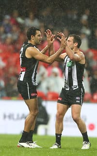 Jarryd Blair helps Daniel Wells celebrate his 250th game