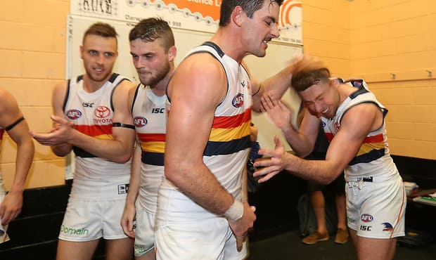 DARWIN, AUSTRALIA - JULY 15:  Taylor Walker and Rory Atkins of the Crows celebrate after the Crows defeated the Demons during the round 17 AFL match between the Melbourne Demons and the Adelaide Crows at TIO Stadium on July 15, 2017 in Darwin, Australia.  (Photo by Robert Cianflone/Getty Images/AFL Media)