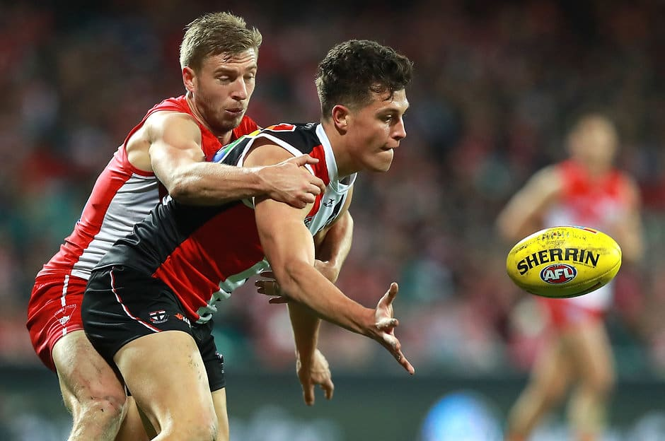 SYDNEY, AUSTRALIA - JULY 22:  Rowan Marshall of the Saints is tackled by Kieren Jack of the Swans during the round 18 AFL match between the Sydney Swans and the St Kilda Saints at Sydney Cricket Ground on July 22, 2017 in Sydney, Australia.  (Photo by Ryan Pierse/Getty Images/AFL Media)