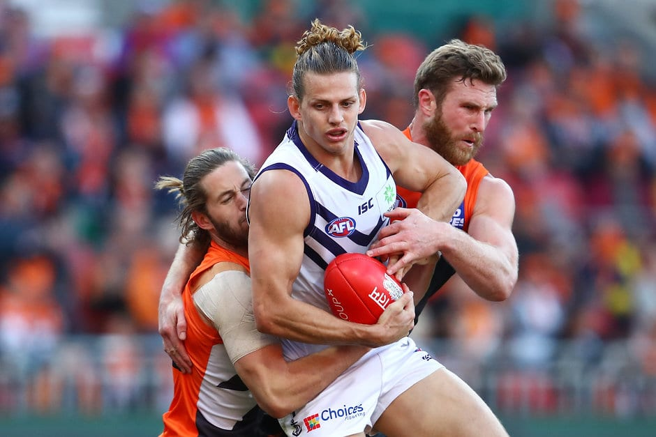 SYDNEY, AUSTRALIA - JULY 29:  Nat Fyfe of the Dockers is tackled by Dawson Simpson of the Giants during the round 19 AFL match between the Greater Western Sydney Giants and the Fremantle Dockers at Spotless Stadium on July 29, 2017 in Sydney, Australia.  (Photo by Cameron Spencer/Getty Images/AFL Media)