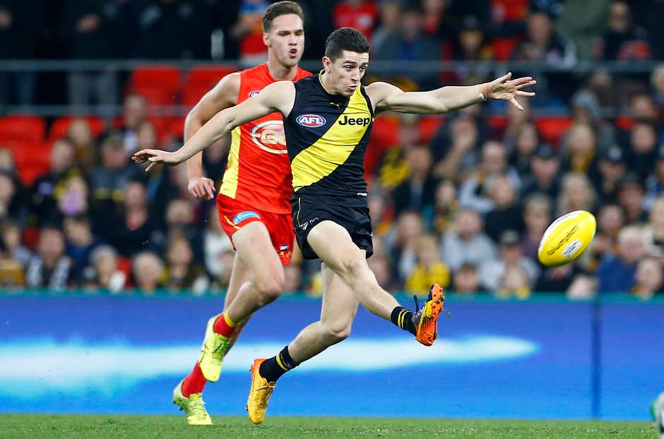 GOLD COAST, AUSTRALIA - JULY 29:Jason Castagna    of the tigers kicks the ball   during the 2017 AFL round 19 match between the Gold Coast Suns and the Richmond Tigers at Metricon Stadium on July 29, 2017 in Gold Coast, Australia. (Photo by Jason O'Brien/AFL Media)