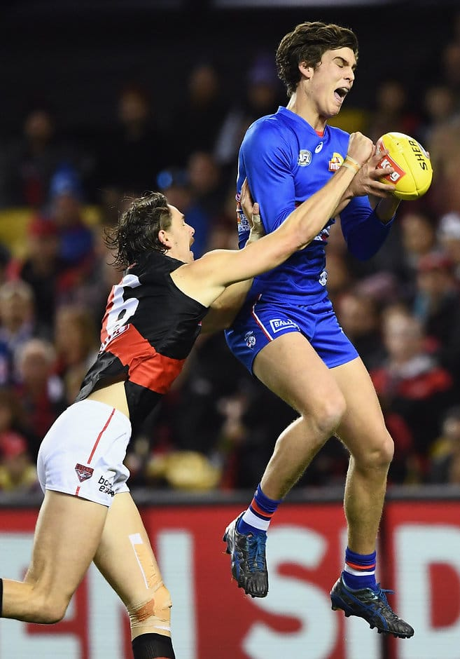 Young dogs surreal moment on daniher afl lewis young marks in front of joe daniher keywords solutioingenieria Gallery