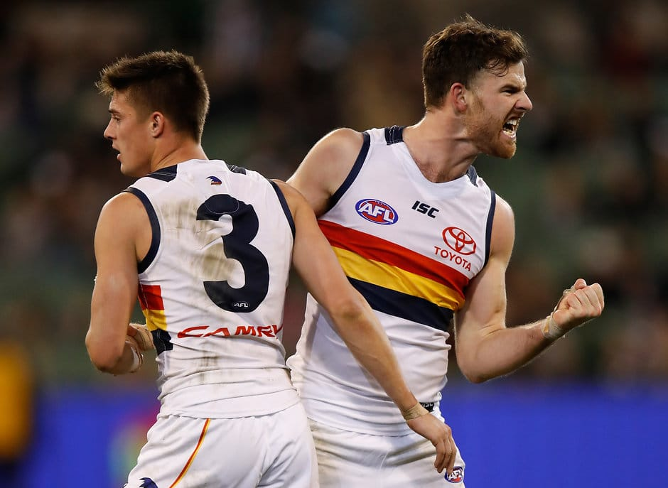 MELBOURNE, AUSTRALIA - JULY 30: Riley Knight (left) and Andy Otten of the Crows celebrate during the 2017 AFL round 19 match between the Collingwood Magpies and the Adelaide Crows at the Melbourne Cricket Ground on July 30, 2017 in Melbourne, Australia. (Photo by Michael Willson/AFL Media)