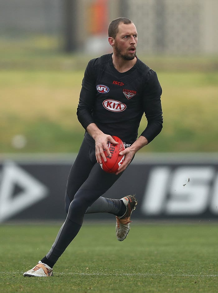 MELBOURNE, AUSTRALIA - AUGUST 02: James Kelly of the Bombers runs with the ball during an Essendon Bombers AFL training session at the Essendon Bombers Club on August 2, 2017 in Melbourne, Australia.  (Photo by Robert Cianflone/Getty Images/AFL Media)