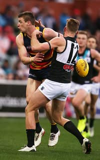 ADELAIDE, AUSTRALIA - AUGUST 06: Josh Jenkins of the Crows competes with Jackson Trengove of the Power during the 2017 AFL round 20 match between the Adelaide Crows and the Port Adelaide Power at Adelaide Oval on August 06, 2017 in Adelaide, Australia. (Photo by James Elsby/AFL Media)