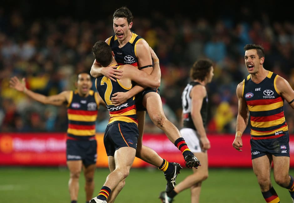 ADELAIDE, AUSTRALIA - AUGUST 06: Brad Crouch and Mitch McGovern of the Crows celebrates a goal during the 2017 AFL round 20 match between the Adelaide Crows and the Port Adelaide Power at Adelaide Oval on August 06, 2017 in Adelaide, Australia. (Photo by James Elsby/AFL Media)