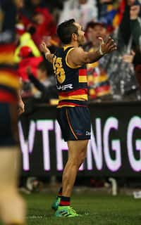 ADELAIDE, AUSTRALIA - AUGUST 06: Eddie Betts of the Crows celebrates a goal during the 2017 AFL round 20 match between the Adelaide Crows and the Port Adelaide Power at Adelaide Oval on August 06, 2017 in Adelaide, Australia. (Photo by James Elsby/AFL Media)