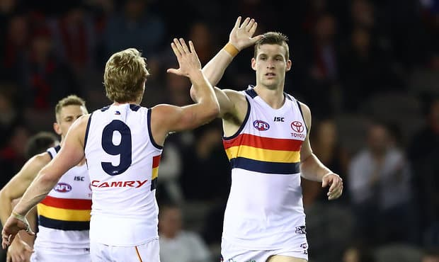 Adelaide sealed a top-two spot with Saturday night's win over Essendon