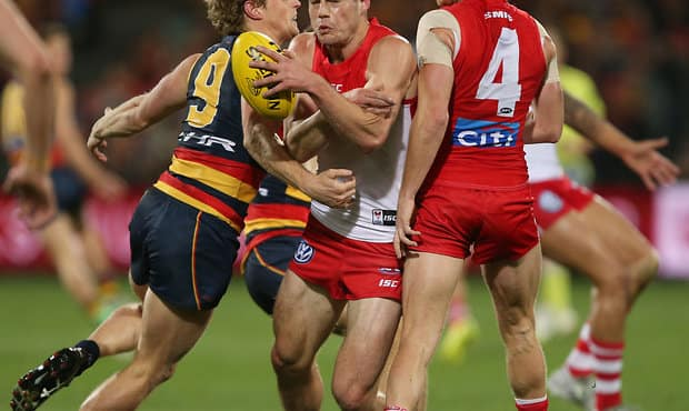 ADELAIDE, AUSTRALIA - AUGUST 18: Rory Sloane of the Crows tackles Nic Newman of the Swans during the 2017 AFL round 22 match between the Adelaide Crows and the Sydney Swans at Adelaide Oval on August 18, 2017 in Adelaide, Australia. (Photo by James Elsby/AFL Media)