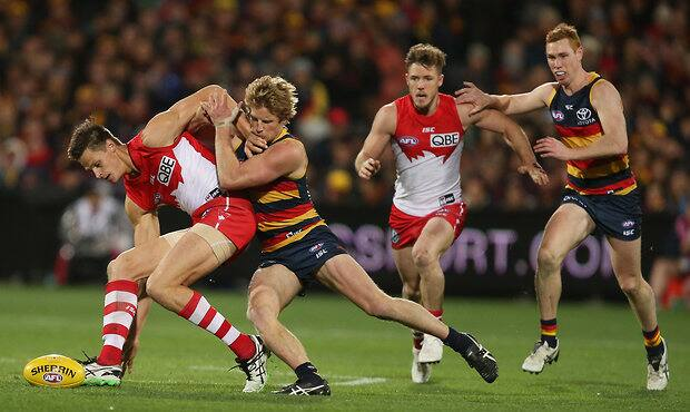 Rory Sloane tackles Sydney's Callum Sinclair during the Friday night clash at Adelaide Oval