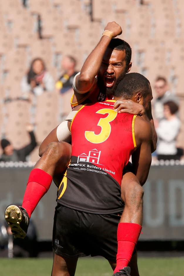 The Papua New Guinea players were ecstatic on the final siren - AFL,International Cup