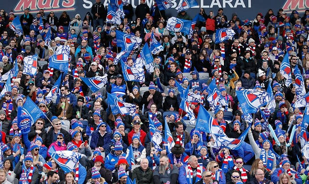 BALLARAT, AUSTRALIA - AUGUST 19: Bulldogs fans wave their flags during the 2017 AFL round 22 match between the Western Bulldogs and the Port Adelaide Power at Mars Stadium on August 19, 2017 in Ballarat, Australia. (Photo by Adam Trafford/AFL Media) - Western Bulldogs