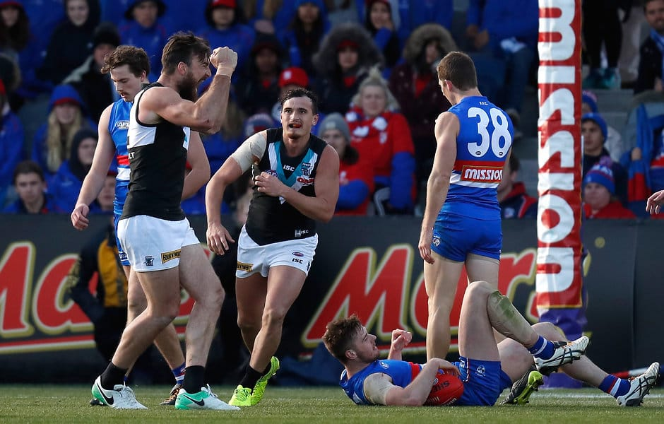 BALLARAT, AUSTRALIA - AUGUST 19: Players react as the final siren sounds during the 2017 AFL round 22 match between the Western Bulldogs and the Port Adelaide Power at Mars Stadium on August 19, 2017 in Ballarat, Australia. (Photo by Michael Willson/AFL Media)