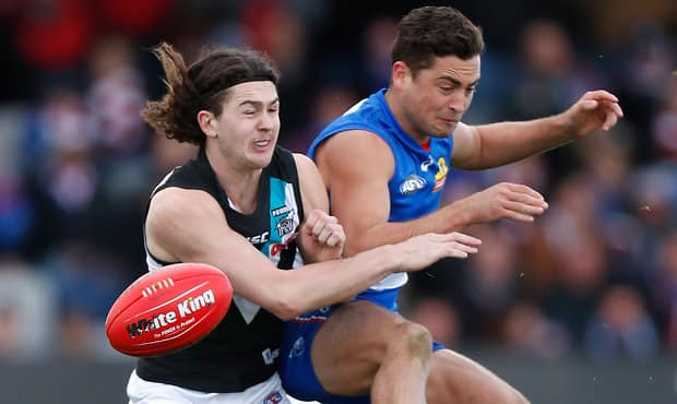 BALLARAT, AUSTRALIA - AUGUST 19: Luke Dahlhaus of the Bulldogs and Darcy Byrne-Jones of the Power compete for the ball during the 2017 AFL round 22 match between the Western Bulldogs and the Port Adelaide Power at Mars Stadium on August 19, 2017 in Ballarat, Australia. (Photo by Michael Willson/AFL Media)