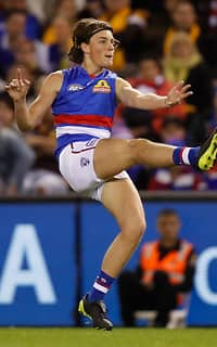 MELBOURNE, AUSTRALIA - AUGUST 25: Debutant, Patrick Lipinski of the Bulldogs kicks the ball during the 2017 AFL round 23 match between the Hawthorn Hawks and the Western Bulldogs at Etihad Stadium on August 25, 2017 in Melbourne, Australia. (Photo by Michael Willson/AFL Media) - Patrick Lipinski,Western Bulldogs