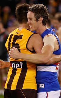 Luke Hodge and Bob Murphy embrace after the game