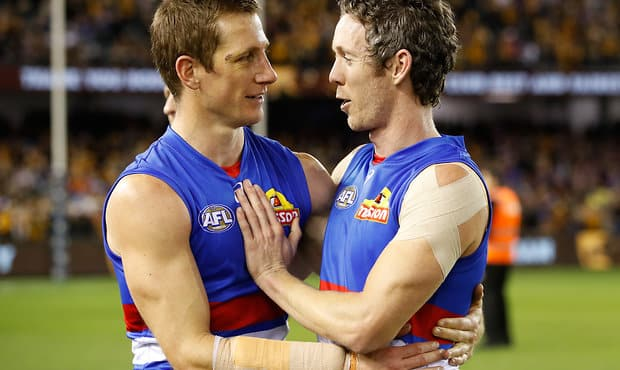 MELBOURNE, AUSTRALIA - AUGUST 25: Robert Murphy of the Bulldogs (right) is congratulated after his final AFL match by Dale Morris of the Bulldogs during the 2017 AFL round 23 match between the Hawthorn Hawks and the Western Bulldogs at Etihad Stadium on August 25, 2017 in Melbourne, Australia. (Photo by Adam Trafford/AFL Media) - Western Bulldogs,Dale Morris