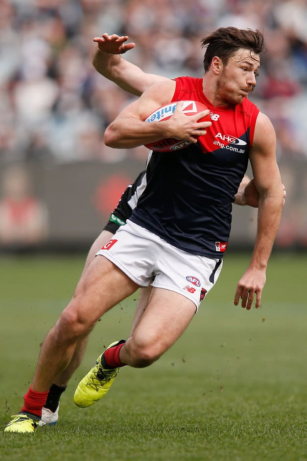 MELBOURNE, AUSTRALIA - AUGUST 26: Michael Hibberd of the Demons runs with the ball  during the round 23 AFL match between the Collingwood Magpies and the Melbourne Demons at Melbourne Cricket Ground on August 26, 2017 in Melbourne, Australia.  (Photo by Darrian Traynor/Getty Images/AFL Media)