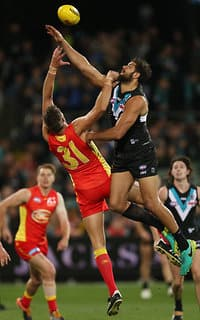 Gold Coast's Keegan Brooksby competes with Port Adelaide's Paddy Ryder in the ruck